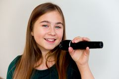 Girl singing with a microphone royalty free stock photography