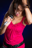 Girl Singing with Microphone Royalty Free Stock Image