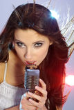Girl singing in retro mic Stock Photography