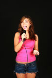 Girl singing and smiling Royalty Free Stock Photography