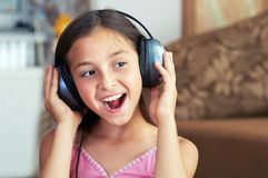 The girl is singing the song Stock Photos