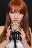 Singing girl in headphones. Royalty Free Stock Image