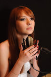 Singing girl in headphones. Royalty Free Stock Photo