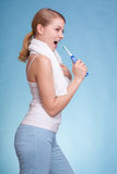 Girl singing to toothbrush. Dental teeth care. Stock Image