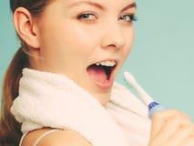 Girl singing using toothbrush. Stock Images