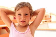 Girl in singlet put her hands behind head Royalty Free Stock Image