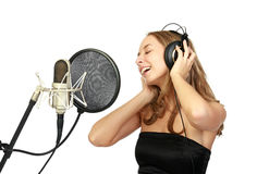 A girl sings Royalty Free Stock Photo
