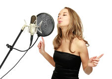 A girl sings Stock Photos