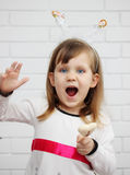 Girl sings. Beautiful, blue-eyed girl in a celebratory Headband Stock Photos