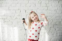 The girl sings in a microphone royalty free stock images