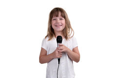 The girl sings with a microphone in hands. On a white background Stock Photos