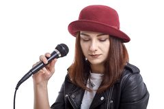 Free Girl Sings With A Microphone In His Hand Stock Photos - 160725233