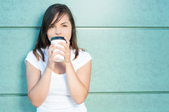 Girl sipping fresh coffee and being dreamy Stock Images