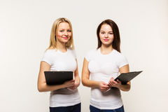 Two girls are isolated against Stock Images