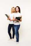 Girls twins with plagshety in hands Royalty Free Stock Photography