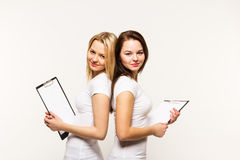 Girl sisters in t-shirts it's isolated Stock Photography