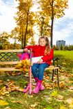 Girl sit in autumn park Royalty Free Stock Photos