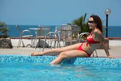 Girl sit at basin Royalty Free Stock Photo
