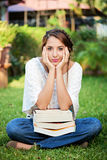 Girl sit with books Stock Photos