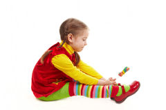 Girl sit with candy. And want it yoo mutch Royalty Free Stock Images