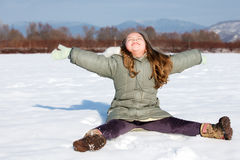 Free Girl Sit Down In The Snow Royalty Free Stock Photos - 22990798