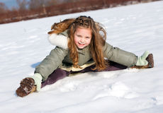 Girl sit down in the snow Royalty Free Stock Photo