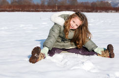 Girl sit down in the snow Royalty Free Stock Image