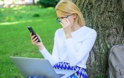 Girl sit grass with notebook. Save your time with shopping online. Sales manager occupation benefits. Woman with laptop. In park order item on phone. Girl takes stock photos