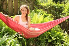 Girl sit in a hammock Stock Images