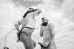 Girl sit on handlebar of his bike. Man bearded hipster rides girlfriend on his bike. Girl likes he rides her on. Handlebar. Why women more attracted biker guys stock images