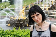 Girl sit near the fountain Stock Image
