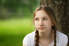 Girl sit near tree in park Royalty Free Stock Photos