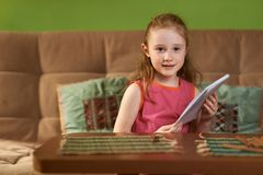 Girl sit with notebook in hand Royalty Free Stock Image
