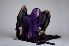 Girl sit in purple fury cosplay costume character Stock Images