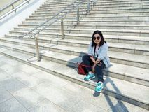 Girl sit on the stair Royalty Free Stock Photos