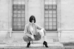 Girl sit on stone fence on house facade in paris, france Royalty Free Stock Photo