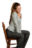 Girl sit on wooden chair. Royalty Free Stock Photography