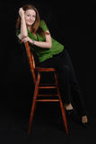 Girl sit on wooden chair. Stock Photos