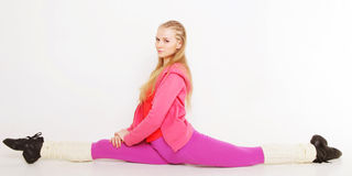 Girl  siting on gym split on white background Royalty Free Stock Image