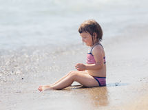 Girl siting on sand beach Royalty Free Stock Image