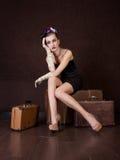 Girl sits on a bag Stock Photos