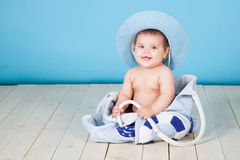 Girl sits in a bag hat summer Royalty Free Stock Image