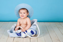 Girl sits in a bag hat summer Stock Images