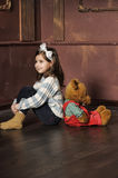 Girl sits with  the bear Stock Image