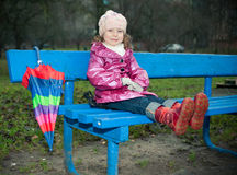 Girl sits on bench Royalty Free Stock Photos