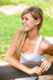 Girl sits on bench Stock Image