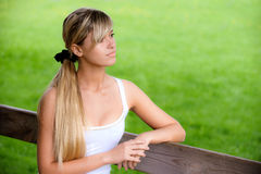 Girl sits on bench Royalty Free Stock Images