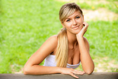Girl sits on bench Royalty Free Stock Photo