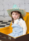 Girl sits in the big road suitcase Royalty Free Stock Photos