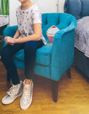 Girl sits on a blue vintage chair. Girl sits on a blue chair Royalty Free Stock Photos